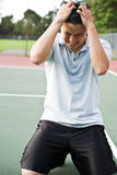 Disappointed tennis player royalty free stock images