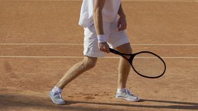 Disappointed tennis player hitting racket against ground, sportsman losing game. Stock footage stock video