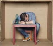 Disappointed unemployed man drinks alcohol Royalty Free Stock Images