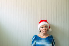 Disappointed woman with Christmas Santa Claus hat Stock Images
