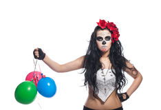 Disappointed woman in dead mask with ballons Royalty Free Stock Image