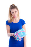 Disappointed woman with gift Stock Photo