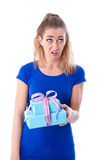 Disappointed woman with gift Stock Images