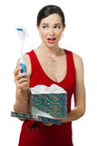 Disappointed woman holding dish brush gift. Stock Image