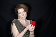 Disappointed woman with jewelry box Royalty Free Stock Photos