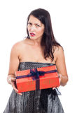 Disappointed woman with present Royalty Free Stock Photography