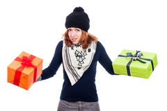 Disappointed woman with presents. Disappointed winter woman holding two presents, isolated on white background Stock Photo