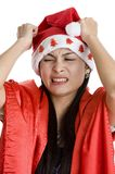 Disappointed woman with santa claus hat Stock Images