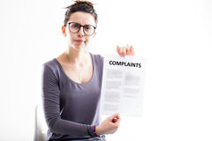 Disappointed woman sending complaints to you Stock Photography