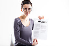 Disappointed woman sending complaints to you Stock Photos