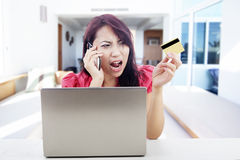 Disappointed woman shopping online Stock Image