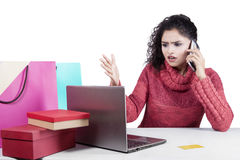 Disappointed woman after shopping online Stock Images