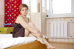 Disappointed woman  sitting on bed Royalty Free Stock Photos