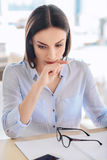 Disappointed woman sitting at the table Royalty Free Stock Images