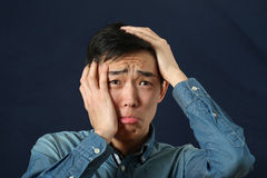 Disappointed Young Asian Man Crying Stock Photo