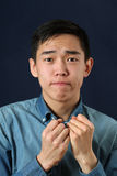 Disappointed young Asian man Stock Photos