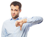 Disappointed young business man with thumb down. Stock Photos