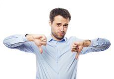 Disappointed young business man with thumb down. Stock Photo