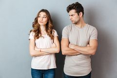 Disappointed young couple standing with arms folded Royalty Free Stock Image