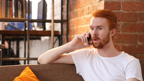 Disappointed Young man getting sad news on the phone, Talking Stock Photography