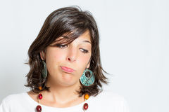 Disappointed. Young woman with a disappointed expression looking down Royalty Free Stock Images