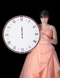 Disappointed young woman in gown & midnight clock Stock Photos