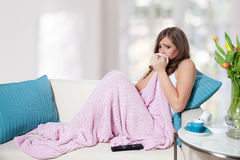 Disappointed young woman watching TV Royalty Free Stock Photos