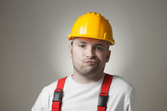 Disappointed young worker Stock Photography