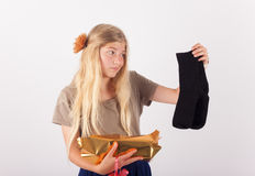 Disappointing gift - a pair of black socks Royalty Free Stock Images