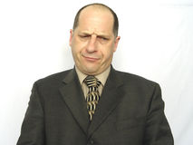 Disappointment. Businessman Looking a someone or something with a disappointing face, with white background Stock Photo