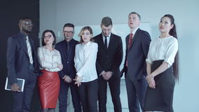Disappointment of business team. Team of businesspeople standing together in conference room and react to bad news as if just learned inconvenient information stock footage