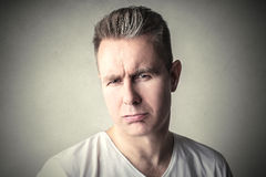 Disappointment. Disappointed man's portrait on a plain background Royalty Free Stock Photos