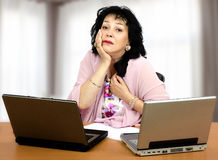 Disappointment on the first date online. Mature woman is disappointed with the very first time she has just met him online. Black haired woman sits in front of Stock Photo