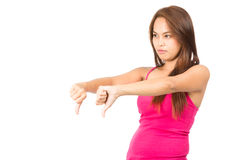 Disapproval Asian Female Thumbs Down Profile Away. Profile of beautiful, frowning Asian female looking away from camera with pink sleeveless shirt looking away Stock Images