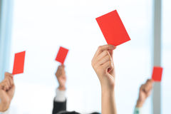 Disapproval. A group of people declined something showing red card on the foreground Stock Photography