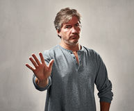 Disapproval man portrait. Disapproval refusing man gesture over gray wall background Royalty Free Stock Images