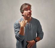 Disapproval man portrait. Disapproval refusing man gesture over gray wall background Royalty Free Stock Photography