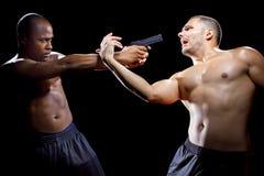Disarming a Gun Royalty Free Stock Image