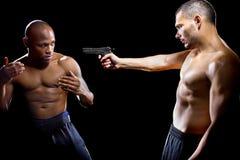 Disarming a Gun Stock Images
