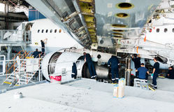 Disassembled airplane for repair and modernization in jet hangar Royalty Free Stock Image