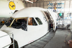 Disassembled airplane for repair and modernization in jet hangar Royalty Free Stock Photo