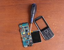 Disassembled broken cell phone repair Stock Photography