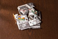 Disassembled broken compact digital camera parts Royalty Free Stock Images