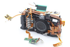 Disassembled camera with exposed copper ribbons Royalty Free Stock Photo