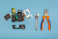 Disassembled camera with tools Royalty Free Stock Photo
