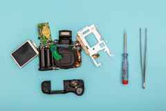 Disassembled camera with tools Royalty Free Stock Images