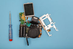 Disassembled camera and tools Royalty Free Stock Photography