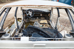 Disassembled car at an automobile junkyard Royalty Free Stock Photography