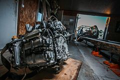 Disassembled car engine lying on the floor stock images