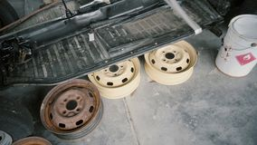 Disassembled car, old and colored car wheel disk.  stock video
